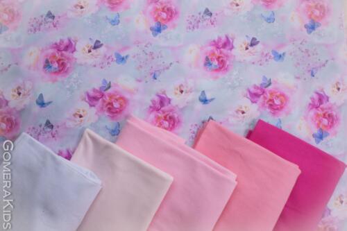 Puuvillane  trikotaaž roosad lilled ja libilkad udus